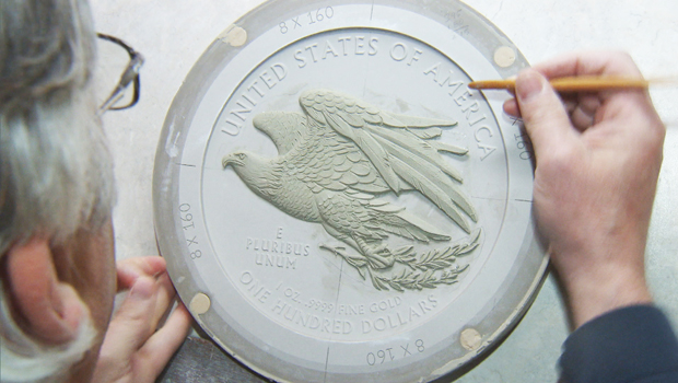 US Mint Lead Scultor sculpts an Eagle coin in clay